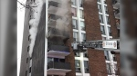 Ottawa firefighters battled a fire in an apartment on the fourth floor of a building on Brittany Drive. (Photo courtesy: Twitter/OttFire)