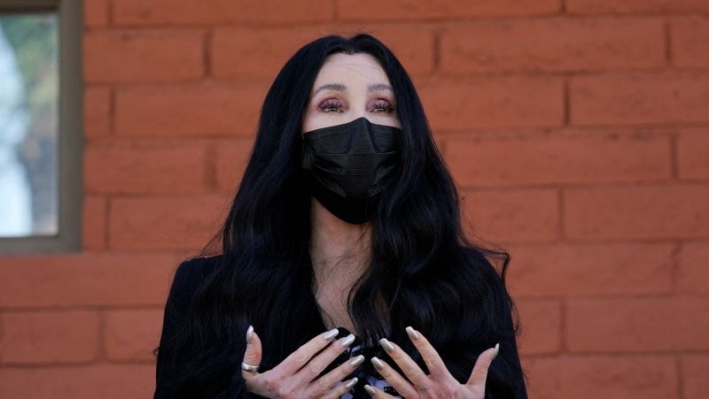 In this Oct. 26, 2020, file photo, Cher speaks near a polling station as she campaigns for Democratic presidential candidate Joe Biden, in Phoenix. (AP Photo/Ross D. Franklin, File)