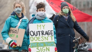 People take part in a climate change protest in Montreal, Saturday, Nov. 21, 2020, as the COVID-19 pandemic continues in Canada and around the world. THE CANADIAN PRESS/Graham Hughes