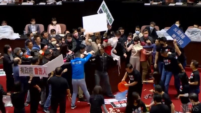 Fights broke out in Taiwan's parliament over the upcoming lift of a ban on U.S. pork and beef imports.