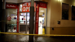 Police tape surrounds a Tim Hortons in Vancouver late Thursday, Nov. 26, 2020.