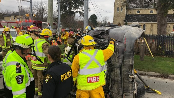 Emergency crews pull two patients from a vehicle in a crash in Arva Ont. on Nov. 27, 2020. (London Fire Dept./Twitter)