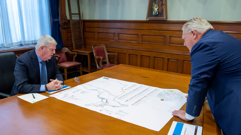 Ontario Premier Doug Ford and former head of the Canadian Armed Forces Gen. Rick Hillier look over a map in the Premier's office at the Ontario Legislature in Toronto. THE CANADIAN PRESS/Frank Gunn