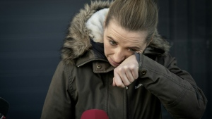 Denmark's Prime Minister Mette Frederiksen wiped away tears as she visited a mink farm affected by the culling on Friday. (AFP)