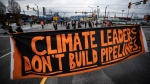 A banner is strung across the road during a protest blocking access to the Port of Vancouver, Monday, Nov. 23, 2020. (Darryl Dyck / THE CANADIAN PRESS)