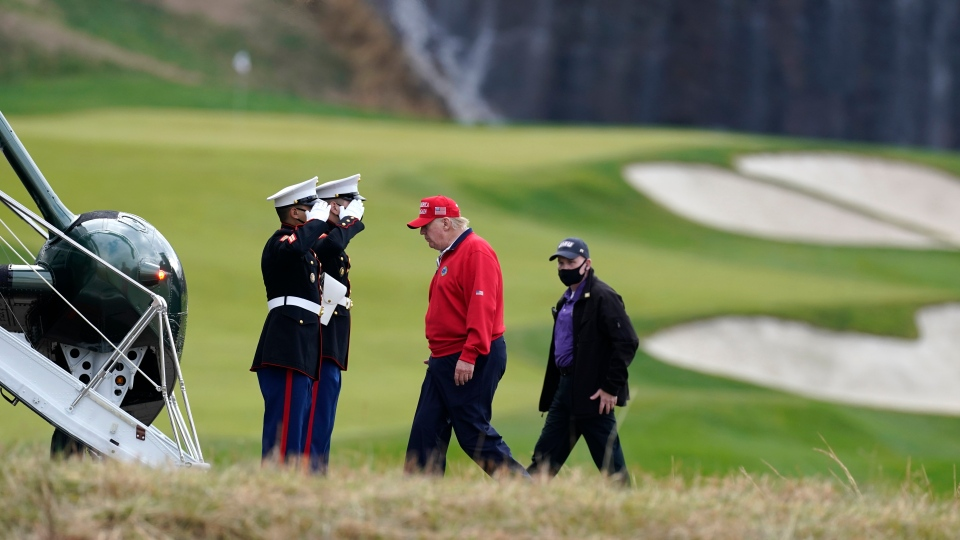 U.S. President Donald Trump walks to board Marine One after playing golf at Trump National Golf Club, Friday, Nov. 27, 2020, in Sterling, Va. (AP Photo/Alex Brandon)