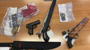 RCMP say they found one sawed-off modified rifle, ammunition, a machete, a BB pistol and several knives in an allegedly stolen car. (RCMP)