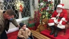 Johnny Hall of West Lorne, Ontario is the first visitor to see Santa Claus in his house at Victoria Park in London, Ontario on Friday, November 27, 2020. Hall is currently battling cancer (Sean Irvine CTV News)