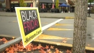 A Black Friday sale sign is pictured at Broadmead Village Shopping Centre in Saanich: (CTV News)