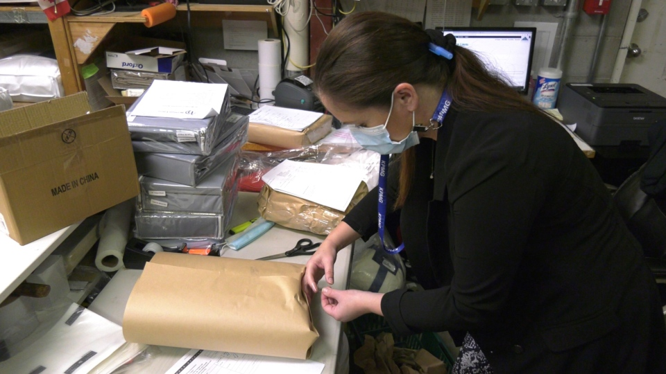 An Heirloom Linens employee is seen packaging up an online order: (CTV News)