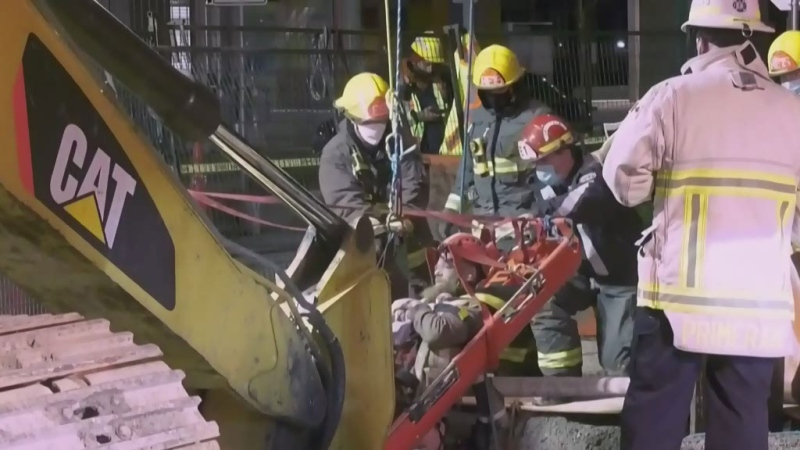Tough rescue as trench collapses