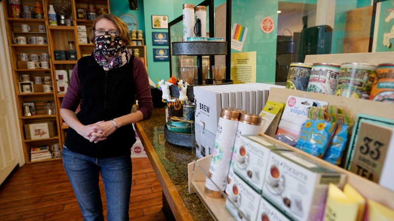 Victoria Leigh Kidd, owner of Hideaway Café, poses in her shop in the Old Town area Wednesday Oct. 7, 2020, in Winchester, Va. The viral pandemic has hammered small businesses across the United States, an alarming trend for an economy that's trying to rebound from the deepest, fastest recession in U.S. history. Small companies are struggling in Winchester, a city of 28,000 that works hard to promote and preserve local enterprises. (AP Photo/Steve Helber)