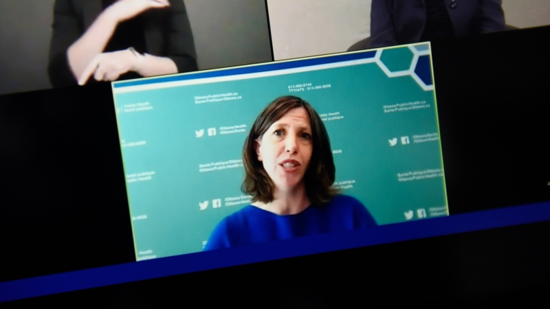 Dr. Vera Etches, Ottawa's chief medical officer of health, is seen on a screen as she participates in a news conference via livestream, after confirming to a reporter earlier in the day that the city had entered a second wave of the COVID-19 pandemic, on Friday, Sept. 18, 2020. THE CANADIAN PRESS/Justin Tang