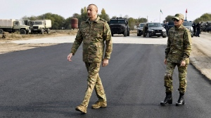 his photo provided late Monday, Nov. 16, 2020, by the Azerbaijan's Presidential Press Office, shows Azerbaijani President Ilham Aliyev and his wife and Azerbaijan's Vice-President Mehriban Aliyeva as they visit those liberated from the occupied districts of Fuzuli and Jabrayil districts of Azerbaijan on Monday, Nov. 16, 2020. (Vugar Amrullayev, Azerbaijani Presidential Press Office via AP)