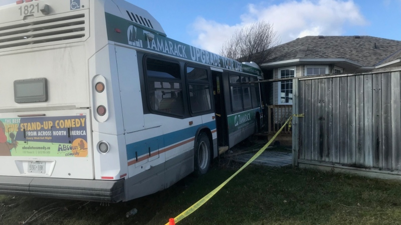 A Kingston Transit bus struck a home on Mohini Place in Kingston, Ont. Saturday, Nov. 28, 2020. No serious injuries have been reported. (Kimberley Johnson / CTV News Ottawa)