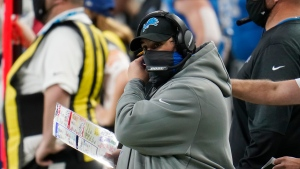 Detroit Lions head coach Matt Patricia adjusts his face mask during the second half of an NFL football game against the Houston Texans, Thursday, Nov. 26, 2020, in Detroit. (AP Photo/Paul Sancya)