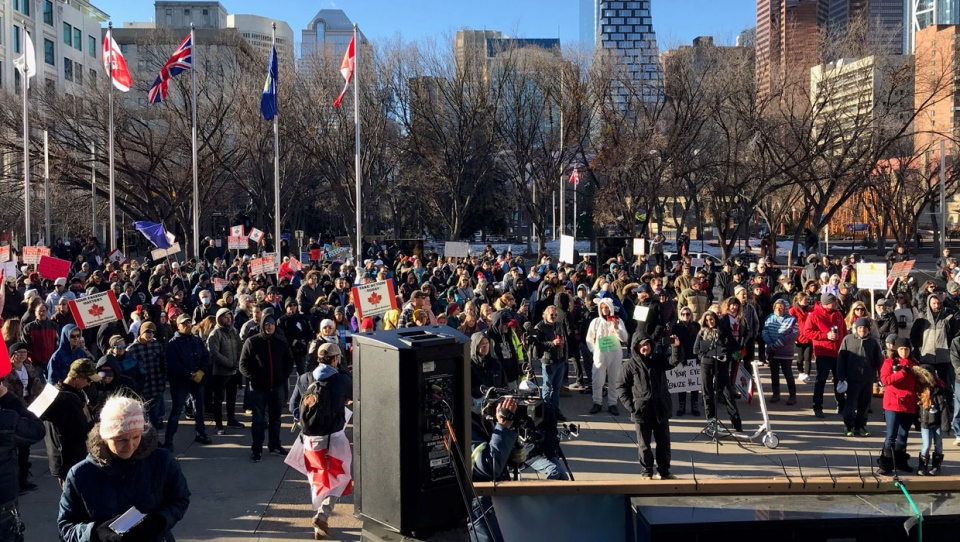 Several hundred people demonstrated outside Calgary city hall on Saturday in contravention of the province's rules against outdoor gatherings.