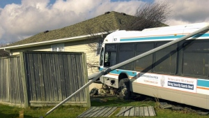 Bus crashes into house