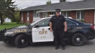 Const. Marc Hovingh in front of his OPP cruiser. (Supplied)
