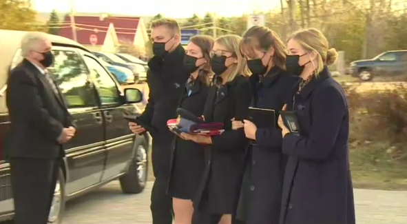 The family of Const. Marc Hovingh leaves the funeral service. Nov. 28/20 (CTV Northern Ontario)