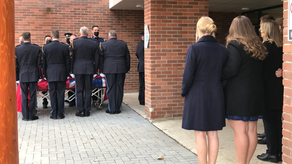 Const. Marc Hovingh's family looks on as his casket is brought into the funeral service. (CTV Northern Ontario)