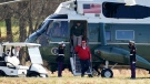U.S. President Donald Trump salutes as he and his son Donald Trump Jr. get off Marine One after it landed at Trump National Golf Club, Saturday, Nov. 28, 2020, in Sterling, Va. (AP Photo/Alex Brandon)