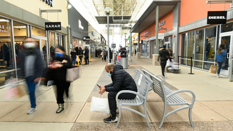 People shop at the Toronto Premium Outlets mall on Black Friday for shopping sales during the COVID-19 pandemic in Milton, Ont., Friday, Nov. 27, 2020. Halton and York region is still open for in person shopping as Toronto and Peel are in lockdown. THE CANADIAN PRESS/Nathan Denette