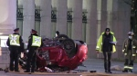 A red vehicle is seen at Princes' Gate on Nov. 29 after a fatal collision. (CP24)