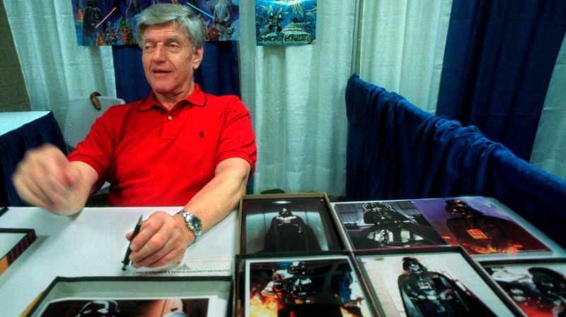 In this file photo dated Friday, May 7, 1999, Dave Prowse, the original Darth Vader from the 'Star Wars Trilogy,' poses during the New York Comic and Fantasy Creators Convention. (AP Photo/Lynsey Addario, FILE)