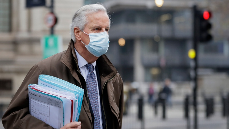 EU Chief Negotiator Michel Barnier walks to a conference centre in Westminster in London, Sunday, Nov. 29, 2020. (AP Photo/Kirsty Wigglesworth)