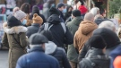 People wear face masks as they shop at a Christmas market in Montreal, Saturday, November 28, 2020, as the COVID-19 pandemic continues in Canada and around the world. THE CANADIAN PRESS/Graham Hughes