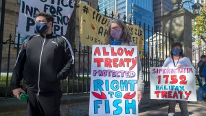 Supporters stand in line as Cheryl Maloney, a member of the Sipekne'katik First Nation, and activist, sells lobster outside the legislature in Halifax on Friday, Oct. 16, 2020. Tensions remain high over an Indigenous-led lobster fishery, based on their treaty rights, as non-Indigenous fishermen want federal regulations enforced to address their concerns about conservation of the resource. THE CANADIAN PRESS /Andrew Vaughan