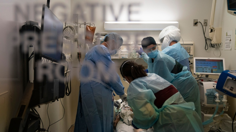 This image shows medical staff treating a COVID-19 patient at the emergency room at Providence Holy Cross Medical Center in Los Angeles. (Jae C. Hong/AP)