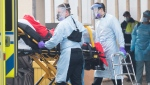 Paramedics transfer a person from Maimonides Geriatric Centre in Montreal, Sunday, November 29, 2020, as the COVID-19 pandemic continues in Canada and around the world. (THE CANADIAN PRESS / Graham Hughes)