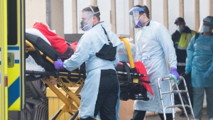 Paramedics transfer a person from Maimonides Geriatric Centre in Montreal, Sunday, November 29, 2020, as the COVID-19 pandemic continues in Canada and around the world. THE CANADIAN PRESS/Graham Hughes