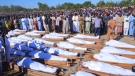 People attend a funeral for those killed by suspected Boko Haram militants in Zaabarmar, Nigeria, Sunday, Nov. 29, 2020. (AP Photo/Jossy Ola)