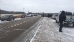 Parishioners at Church of God Restoration, lined the side of the Highway 12 as RCMP cruisers blocked the parking lot Sunday morning. (Source: CTV News/Touria Izri)