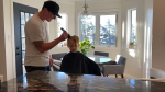 Henry Sitter, 7, has his head shaved by his uncle Dustin Smith on Sunday. Smith was diagnosed with testicular cancer last December. (Courtesy: Amy Sitter)