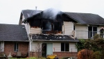 A fire in Pitt Meadows sent two people to hospital for treatment of burns Sunday. (CTV)