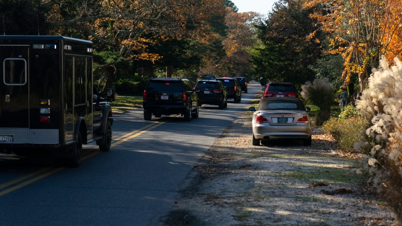 U.S. President-elect Joe Biden's motorcade, moves through the streets of Rehoboth Beach, Del., Sunday, Nov. 29, 2020, en route to Wilmington, Del. (AP Photo/Carolyn Kaster)
