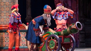 Canadian Astronaut Col. Chris Hadfield (right) appears as a Cannon Doll with his admin co-ordinator Julia Ostrowski (left) and dancer Trygve Cumpston in the National Ballet of Canada's production of the The Nutcracker in Toronto on Tuesday December 24 2013. THE CANADIAN PRESS/Chris Young