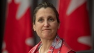 An emotional Deputy Prime Minister and Minister of Intergovernmental Affairs Chrystia Freeland listens to Chief Public Health Officer Theresa Tam read a poem about healthcare workers during a news conference Friday April 24, 2020 in Ottawa. THE CANADIAN PRESS/Adrian Wyld