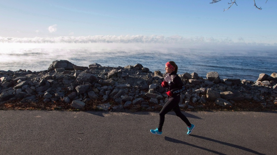 A woman runs beside Lake Ontario in 2018