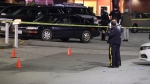Homicide investigators at a shopping centre in Surrey after a fatal shooting on Nov. 29, 2020.