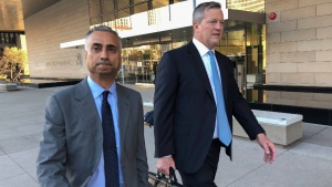 Imaad Zuberi, left, leaves the federal courthouse in L.A. with his attorney Thomas O'Brien, right, on Nov. 22, 2019. (Brian Melley / AP)