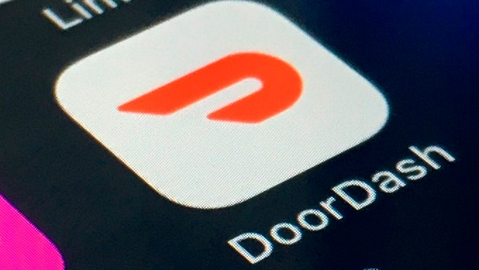 The DoorDash app is shown on a smartphone on Feb. 27, 2020, in New York. Delivery company DoorDash is looking for a valuation of nearly $30 billion when it takes itself public. The company is planning to raise up to approximately $2.8 billion from an initial public offering of 33 million shares. (AP Photo)