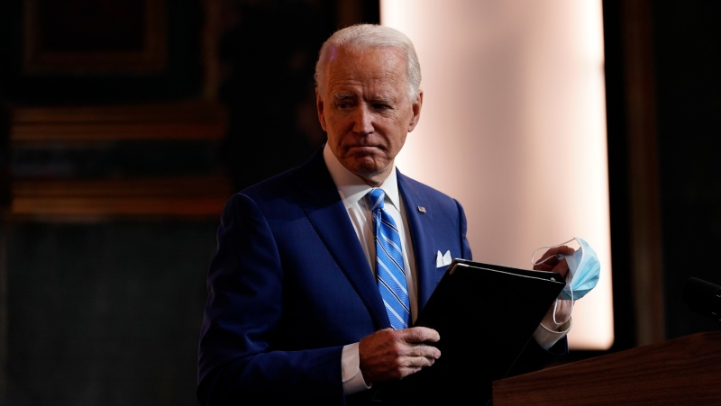 U.S. President-elect Joe Biden leaves after speaking at The Queen theater Wednesday, Nov. 25, 2020, in Wilmington, Del. (AP Photo/Carolyn Kaster)