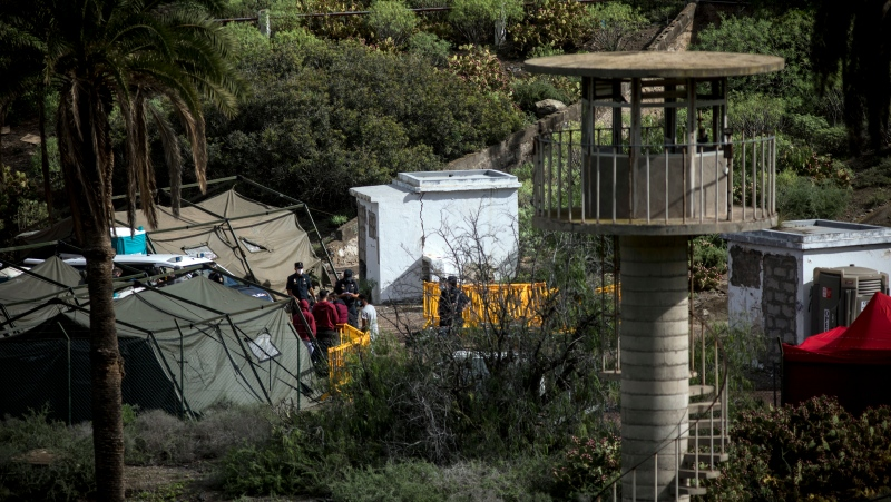 "Migrants are seen at Barranco Seco makeshift migrant camp in Gran Canaria island, Spain on Monday Nov. 30, 2020. Spain has dismantled most of the temporary camp for migrant processing that for over three months became known as the ""dock of shame"" for holding in unfit conditions thousands of Africans arriving lately in the Canary Islands. (AP Photo/Javier Fergo)"