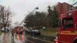 Fire crews work to knock down flames at an apartment building in Etobicoke on Nov. 30, 2020. (CP24)