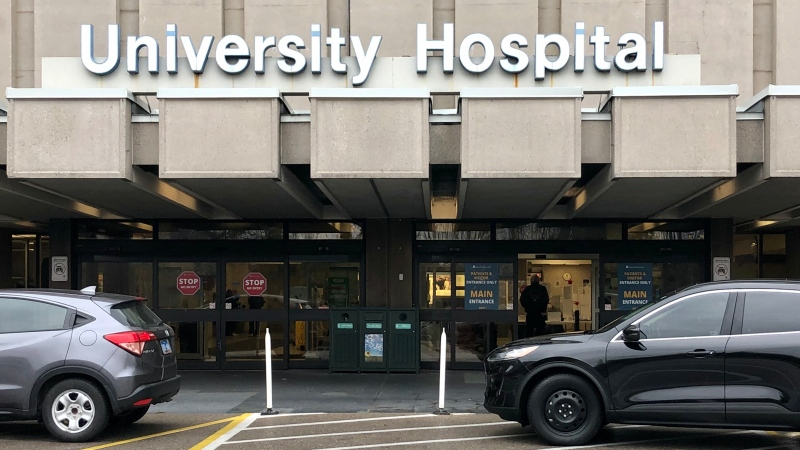 Vehicles are seen stopped outside the London Health Sciences Centre's University Hospital in London, Ont., Monday, Nov. 30, 2020. (Jim Knight / CTV News)